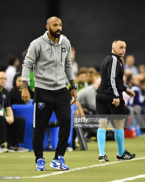 Montreal Impact head coach Thierry Henry looks on against New England Revolution in the second half at Olympic Stadium on February 29 2020 in...