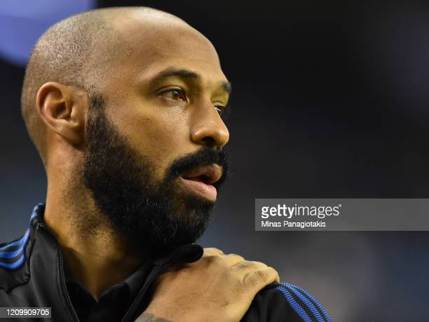 Montreal Impact head coach Thierry Henry looks on ahead of the game against New England Revolution at Olympic Stadium on February 29 2020 in Montreal...