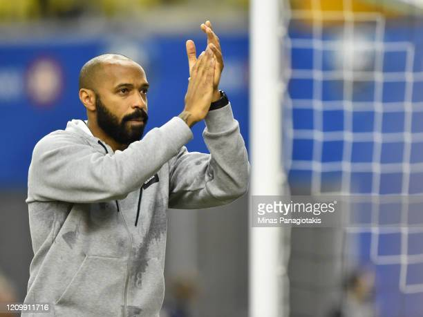 Montreal Impact head coach Thierry Henry reacts after a victory against New England Revolution during the MLS game at Olympic Stadium on February 29...
