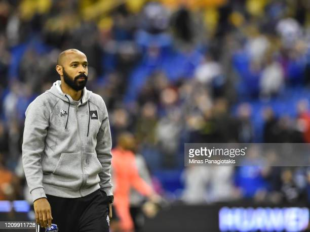 Montreal Impact head coach, Thierry Henry, walks onto the pitch after a victory against New England Revolution during the MLS game at Olympic Stadium...
