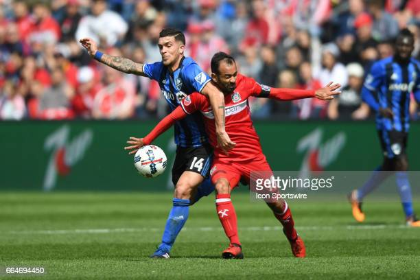 Montreal Impact midfielder Adrian Arregui and Chicago Fire midfielder Juninho battle for the ball during a game between the Montreal Impact and the...