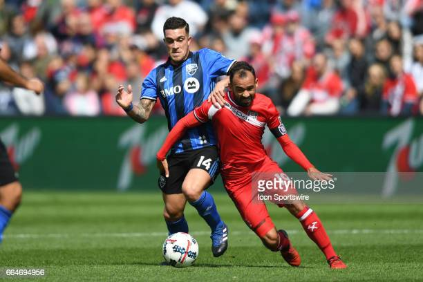 Montreal Impact midfielder Adrian Arregui and Chicago Fire midfielder Juninho fight for the ball in the first half during a game between the Montreal...