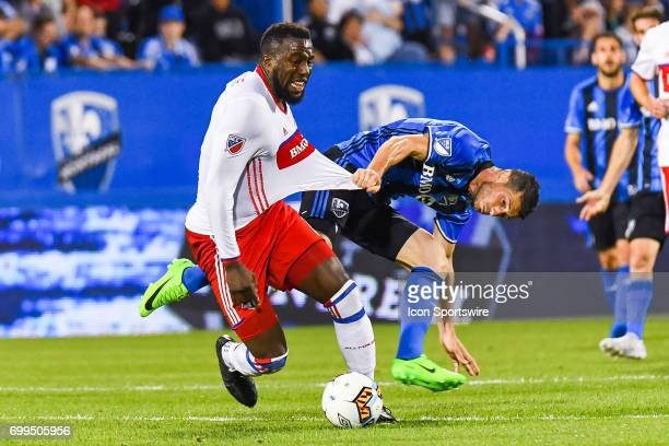 Montreal Impact midfielder Blerim Dzemaili pulling on Toronto FC forward Jozy Altidore shirt while he was in control of the ball during the Toronto...