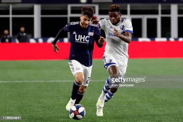 Montreal Impact midfielder Orji Okwonkwo closes down New England Revolution forward Carles Gil during a match between the New England Revolution and...