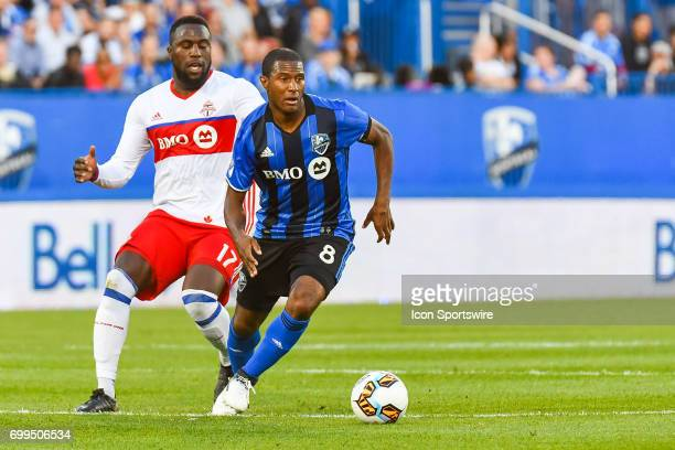 Montreal Impact midfielder Patrice Bernier turning while keeping control of the ball followed by Toronto FC forward Jozy Altidore during the Toronto...