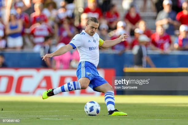 Montreal Impact midfielder Samuel Piette strikes the ball during the soccer match between the Montreal Impact and FC Dallas on June 9 2018 at Toyota...