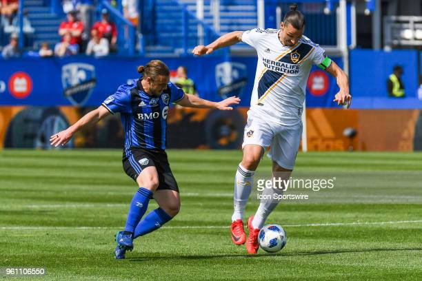 Montreal Impact midfielder Samuel Piette tries to stop Los Angeles Galaxy forward Zlatan Ibrahimovic from controlling the ball during the LA Galaxy...