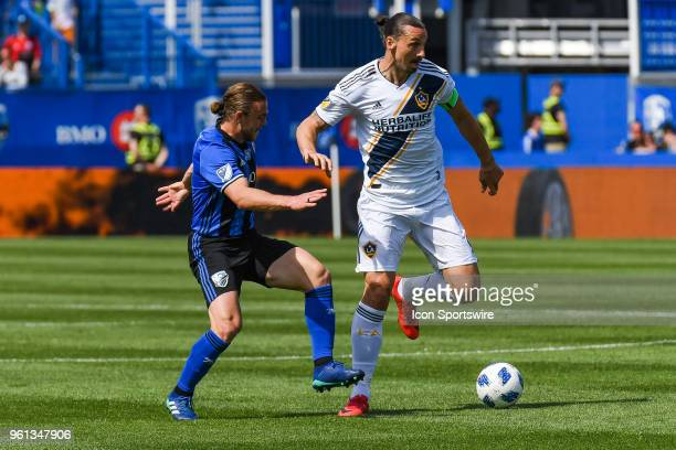Montreal Impact midfielder Samuel Piette tries to stop Los Angeles Galaxy forward Zlatan Ibrahimovic from gaining control of the ball during the LA...