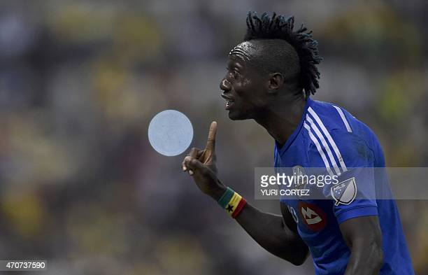 Montreal Impact's forward Dominic Oduro argues with the referee during their CONCACAF Champions League final first leg football match against America...