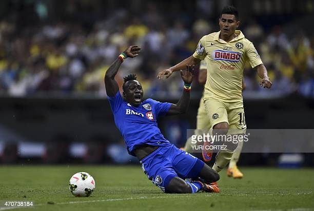 Montreal Impact's forward Dominic Oduro vies for the ball with America's Osvaldo Martinez during their CONCACAF Champions League first leg football...