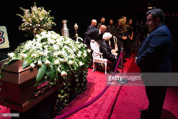 Montreal Mayor Denis Coderre stand in front of the casket of former Montreal Canadiens player Jean Beliveau during the public viewing at the Bell...