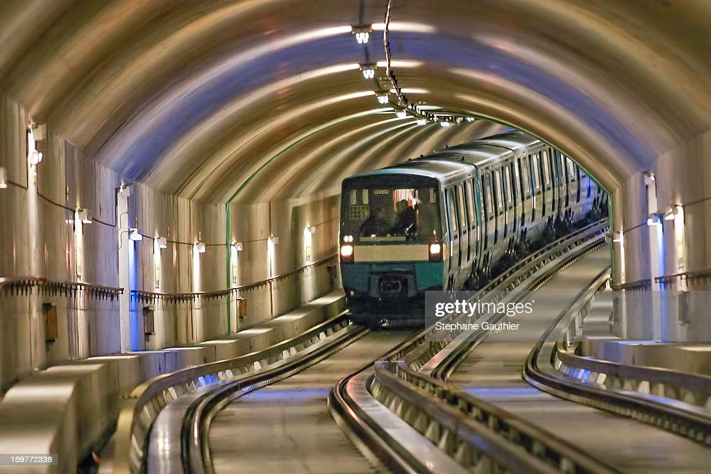 CONTENT] Montreal Metro running in a tunnel arriving at the Montmorency Station (Laval, QC).