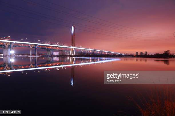montreal new champlain bridge, with water reflection at night - buzbuzzer stock pictures, royalty-free photos & images
