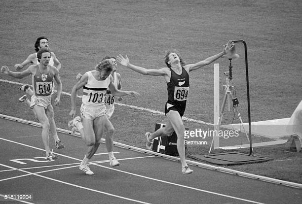 Montreal: New Zealand's John Walker stretches out his arms with joy as he wins the 1500 meter final 7-31. Second was Ivo Vandamme, Belgium, and third...