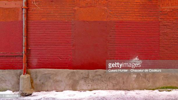 montreal old brick wall with pipe and snow - wall building feature stock pictures, royalty-free photos & images