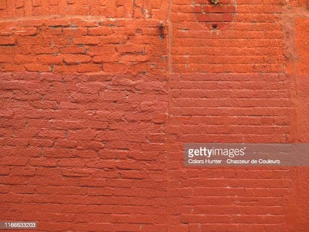 montreal painted and weathered brick wall - mural stock pictures, royalty-free photos & images