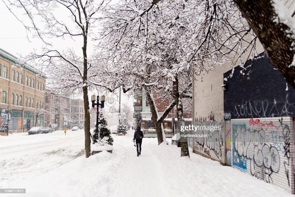 Montreal street with cross-country skiing person after snowstorm. : Stock Photo