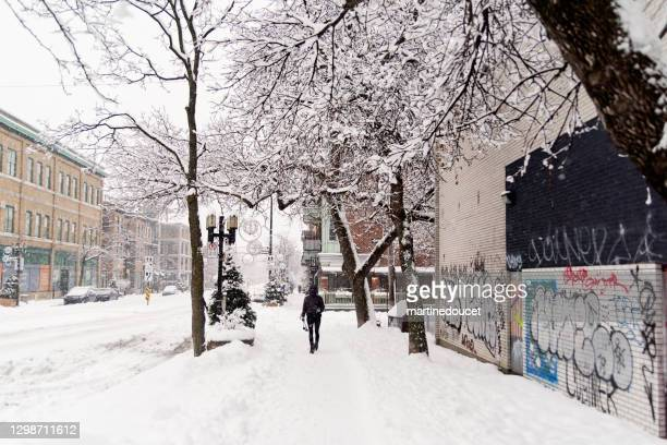 "montreal street with cross-country skiing person after snowstorm. - ""martine doucet"" or martinedoucet stock pictures, royalty-free photos & images"