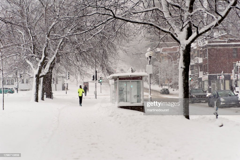 Montreal street with people during snowstorm. : Stock Photo