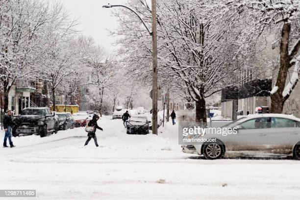 """montreal street with people during snowstorm. - """"martine doucet"""" or martinedoucet stock pictures, royalty-free photos & images"""