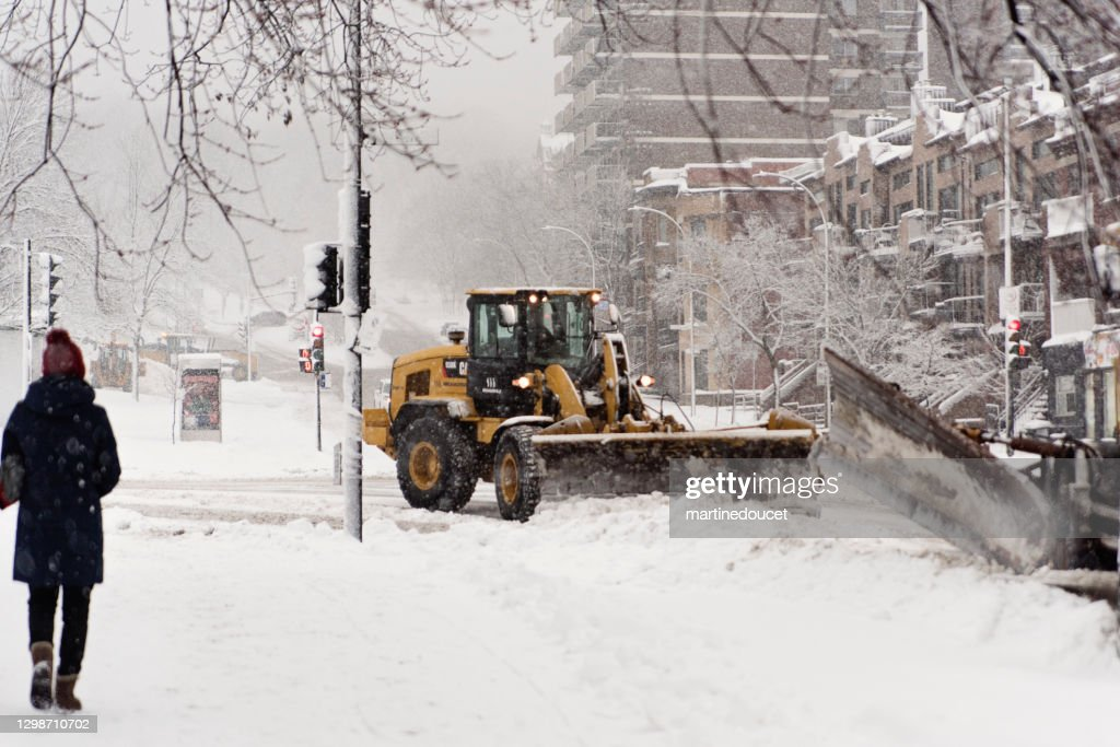 Montreal street with snowplow during snowstorm. : Stock Photo