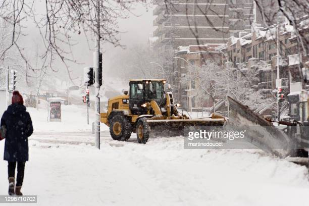 "montreal street with snowplow during snowstorm. - ""martine doucet"" or martinedoucet stock pictures, royalty-free photos & images"