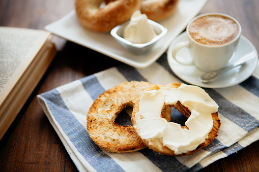 Montreal style bagels on a plate with cream cheese and coffee 903742886