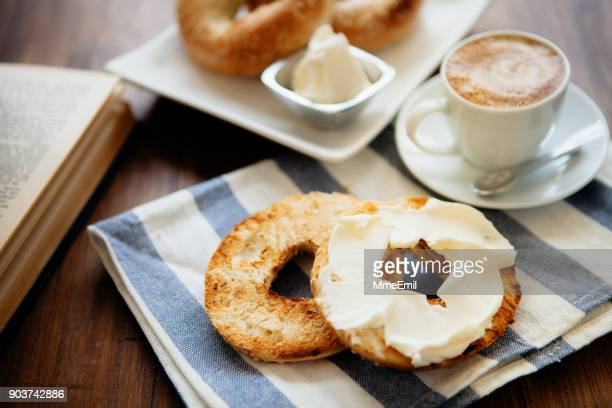 montreal style bagels on a plate with cream cheese and coffee - canadian culture stock pictures, royalty-free photos & images