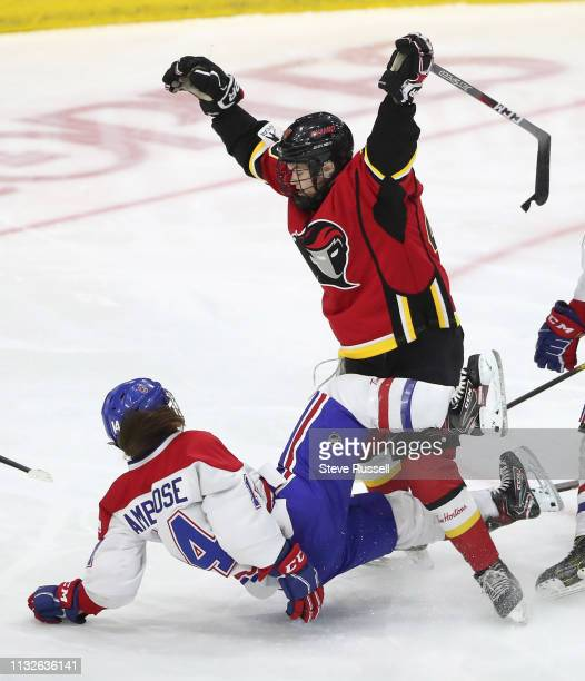 TORONTO ON MARCH 24 Montreal's Erin Ambrose collides with Blayre Turnbull as the The Canadian Women's Hockey League's Clarkson Cup final between...
