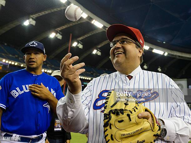 Montreal's Mayor Denis Coderre juggles a baseball prior to the MLB spring training game between the Toronto Blue Jays and the Boston Red Sox at...