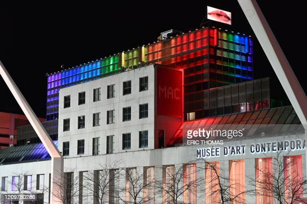 Montreal's museum of modern art is seen on April 11 illuminated in the colours of the rainbow as a sign of hope and in support of victims of the...