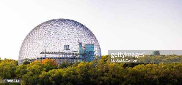 montreal's parc jean-drapeau treetop panoramic view featuring the biosphere and lévis tower - lévis quebec stock pictures, royalty-free photos & images