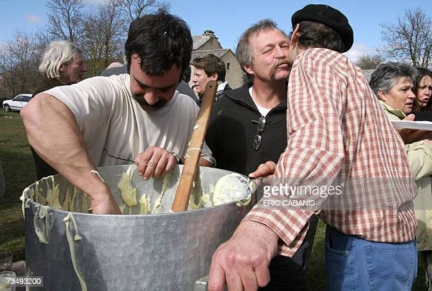 French farmeractivist and candidate for the 2007 presidential election Jose Bove welcomes farmers who prepare a local cheese and potatoes culinary...