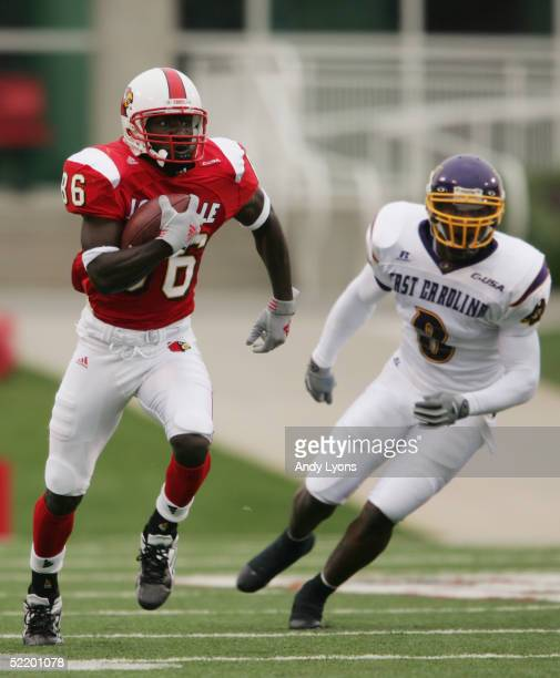 Montrell Jones of the Louisville Cardinals looks to pass during the game against the East Carolina Pirates at Papa John's Stadium on October 2 2004...