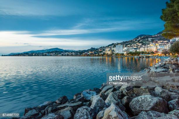 montreux (switzerland) and lake geneva in the evening twilight - montreux stock pictures, royalty-free photos & images