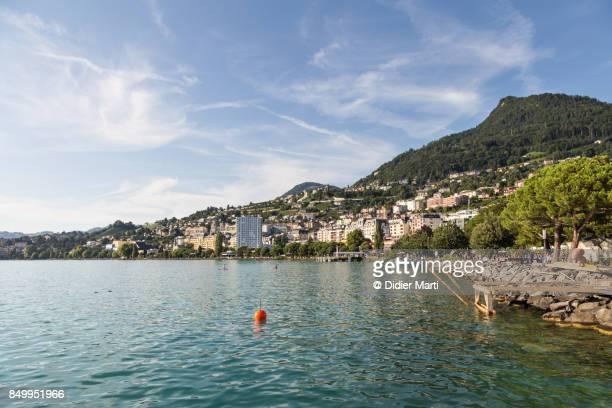 montreux cityscape by lake geneva in switzerland - meer van genève stockfoto's en -beelden