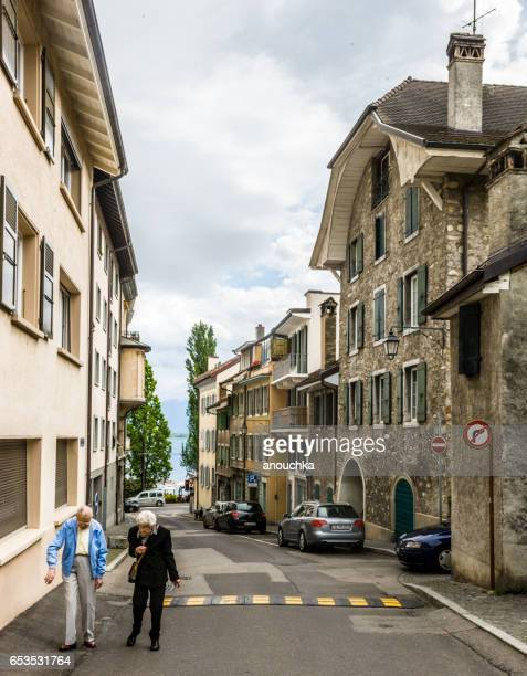 montreux street with senior couple walking, switzerland - vaud canton stock photos and pictures