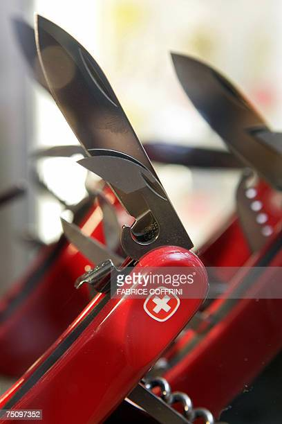 Swiss army knives are displayed 06 July 2007 in a shop in Montreux Symbol of Swiss quality the famous knife will change its colour passing to green...