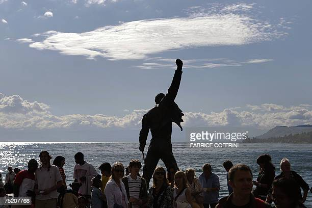 Tribute statue of late Queen singer Freddie Mercury surrounded by tourists on July 6 2007 in Montreux The statue facing Lake Leman was unveiled on...