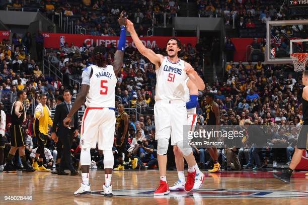 Montrezl Harrell and Boban Marjanovic of the LA Clippers react to a play during the game against the Los Angeles Lakers on April 11 2018 at STAPLES...