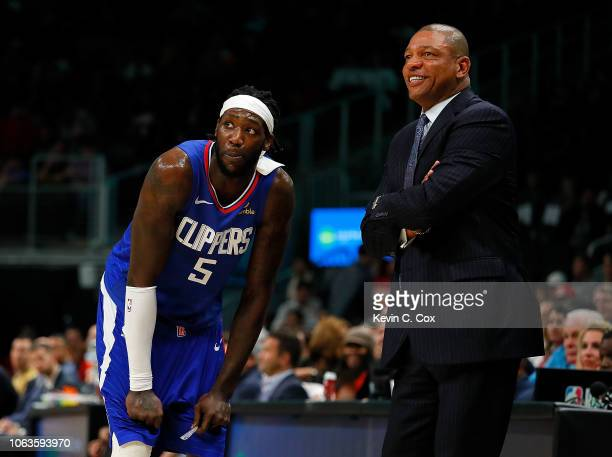 Montrezl Harrell and Doc Rivers of the LA Clippers converse against the Atlanta Hawks at State Farm Arena on November 19 2018 in Atlanta Georgia NOTE...