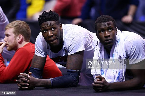Montrezl Harrell and Mangok Mathiang of the Louisville Cardinals look on late in the second half against the Kentucky Wildcats during the regional...