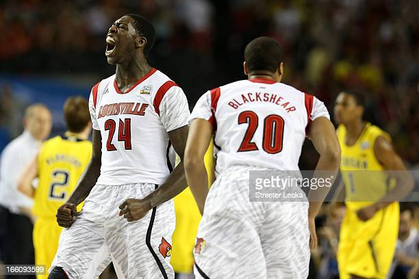Montrezl Harrell and Wayne Blackshear of the Louisville Cardinals react after Harrell dunked the ball in the first half against the Michigan...