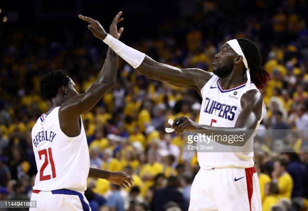 Montrezl Harrell highfives Patrick Beverley of the LA Clippers during their game against the Golden State Warriors in Game Five of the first round of...