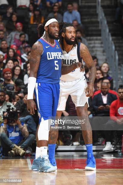 Montrezl Harrell of the LA Clippers and DeAndre Jordan of the Dallas Mavericks defend their positions during the game on December 20 2018 at STAPLES...