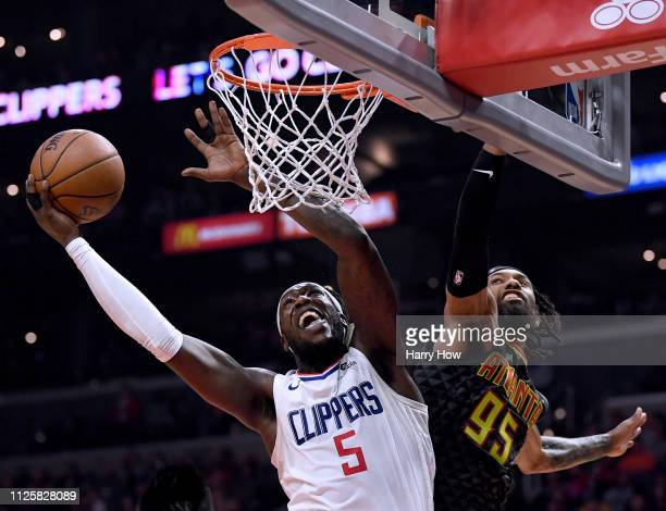 Montrezl Harrell of the LA Clippers attempts a shot around DeAndre' Bembry of the Atlanta Hawks during a 123118 Hawks win at Staples Center on...