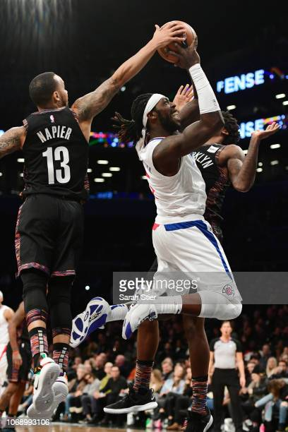 Montrezl Harrell of the LA Clippers attempts a shot but is blocked by Shabazz Napier of the Brooklyn Nets during the game at Barclays Center on...