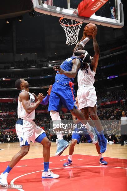 Montrezl Harrell of the LA Clippers blocks the shot against DeAndre Jordan of the Dallas Mavericks on December 20 2018 at STAPLES Center in Los...