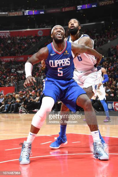 Montrezl Harrell of the LA Clippers boxes out DeAndre Jordan of the Dallas Mavericks on December 20 2018 at STAPLES Center in Los Angeles California...