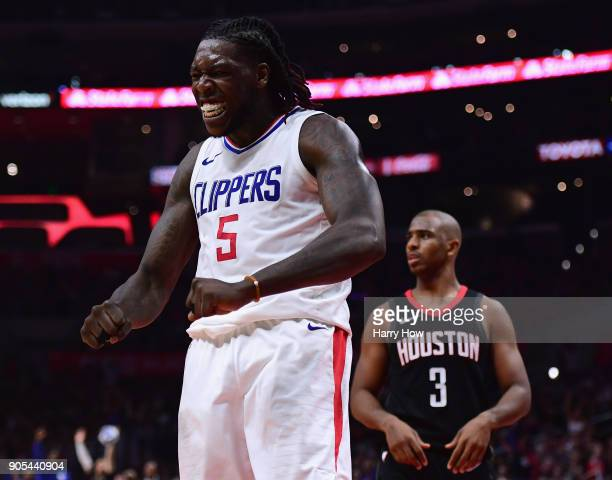 Montrezl Harrell of the LA Clippers celebrates his dunk in front of Chris Paul of the Houston Rockets during a 113102 Clipper win at Staples Center...